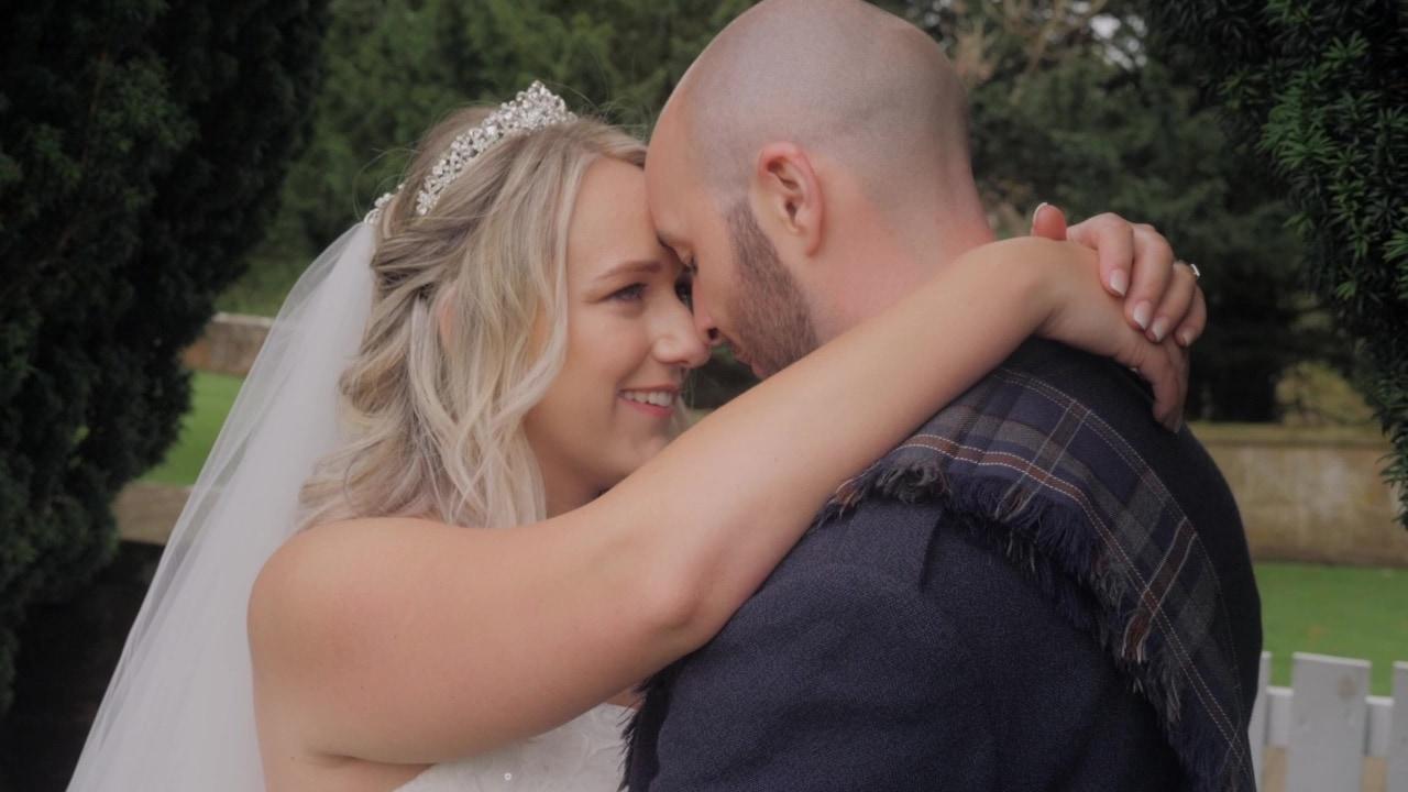 Scottish bride and groom embracing
